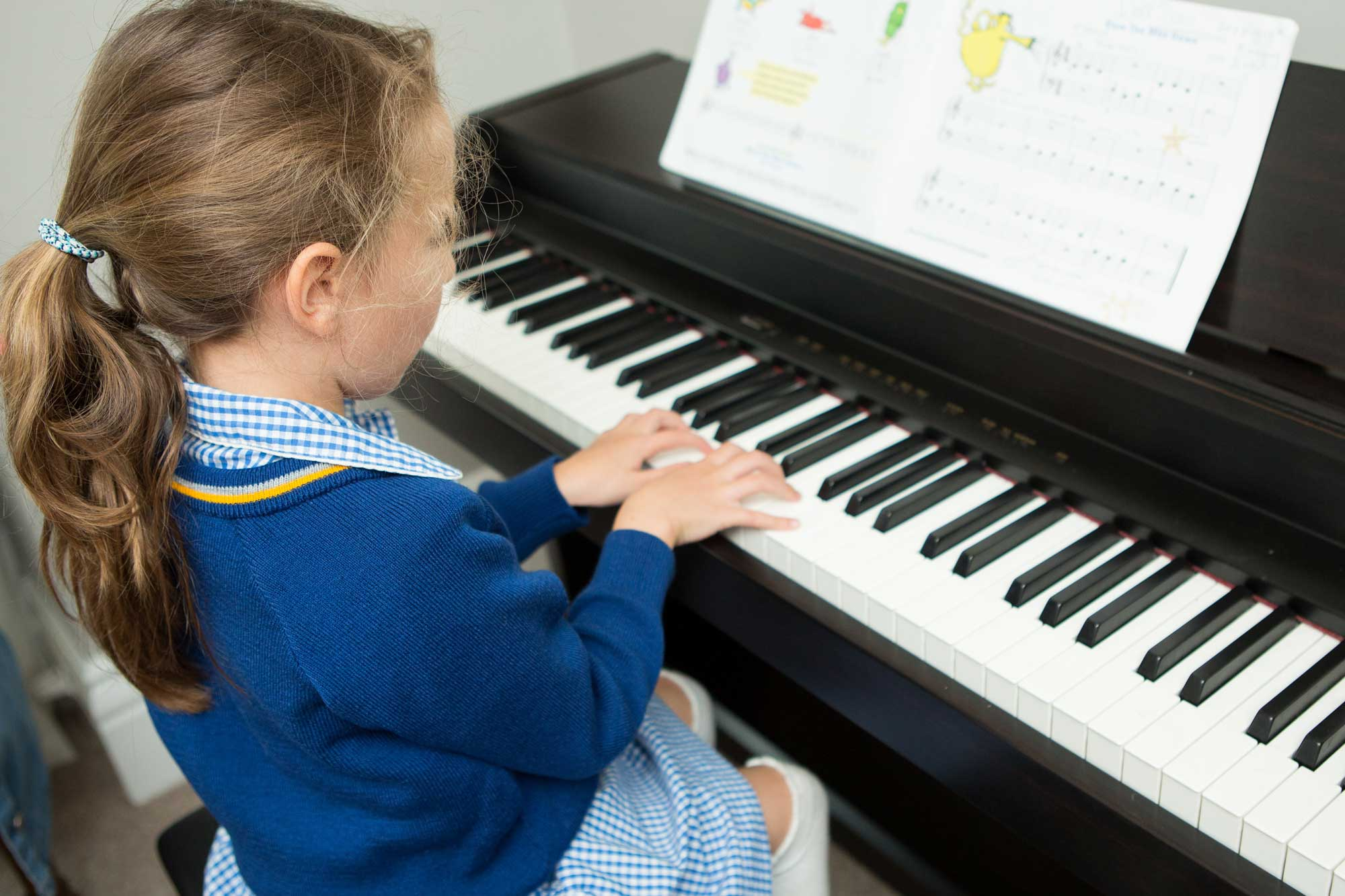 Girl playing piano at Whitehall Independent School